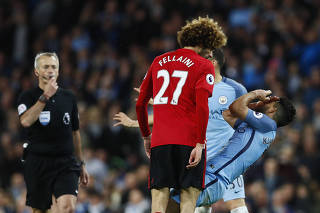 Manchester United's Marouane Fellaini clashes with Manchester City's Sergio Aguero before being sent off by referee Martin Atkinson