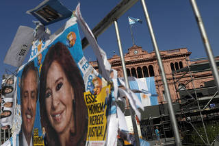 A campaign poster of Argentina's President-elect Alberto Fernandez and his Vice President-elect and former President Cristina Fernandez de Kirchner, is pictured outside the Casa Rosada presidential palace, in Buenos Aires