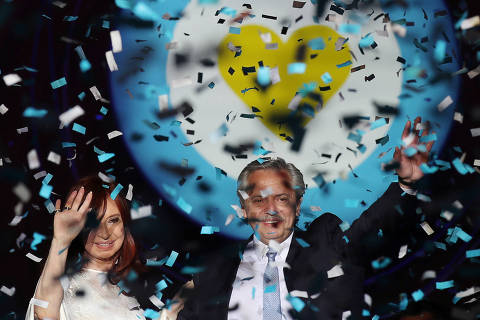 Argentina's President Alberto Fernandez and Vice President Cristina Fernandez de Kirchner on stage outside the Casa Rosada Presidential Palace after inauguration, in Buenos Aires, Argentina December 10, 2019. REUTERS/Ricardo Moraes ORG XMIT: SIN124R