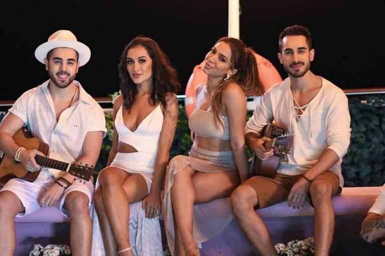 Anitta e o trio Melim em foto promocional para a canção 'Meu Mel'