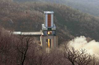 A new engine for an ICBM is tested at a test site at Sohae Space Center