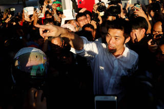 Juangroongruangkit of Thailand's progressive Future Forward Party reacts with his supporters at a sudden unauthorised rally in Bangkok