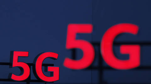 Illuminated 5G logos are on display during the 10th Global mobile broadband forum hosted by Chinese tech giant Huawei in Zurich on October 15, 2019. - Huawei announced on October 16, 2019 that it has passed the 400.000 5G antennas mark, the fifth generation of mobile phones, in the world with 56 operators who have already started to roll out the new mobile network. (Photo by STEFAN WERMUTH / AFP)