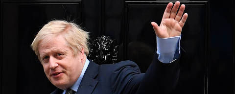 Britain's Prime Minister and Conservative Party leader Boris Johnson arrives at 10 Downing Street in central London on December 13, 2019, following an audience with Britain's Queen Elizabeth II at Buckingham Palace, where she invited him to become Prime Minister and form a new government. - Conservative Prime Minister Boris Johnson on Friday hailed a political