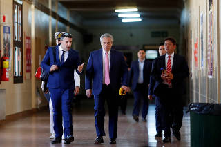 Argentina's President Alberto Fernandez arrives prior to take an exam at the University of Buenos Aires Law School after taking office this week, in Buenos Aires