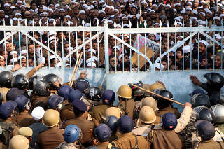 Students of Darul Uloom Nadwatul Ulama are stopped by police during a protest against a new citizenship law, in Lucknow
