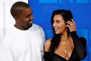 FILE PHOTO: Kim Kardashian and Kanye West arrive at the 2016 MTV Video Music Awards in New York