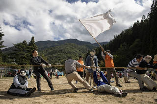 A tug-of-war, with both doll and living participants, during a day on which the village recreated what was once an annual sports festival day, in Nagoro, Japan, Oct. 6, 2019. (Nadia Shira Cohen/The New York Times)