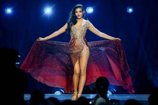 Paweensuda Drouin, of Thailand, competes in the evening gown portion of the Miss Universe pageant at Tyler Perry Studios in Atlanta