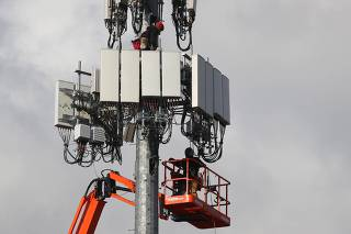 Utility Workers Install 5G Equipment In Cellular Tower