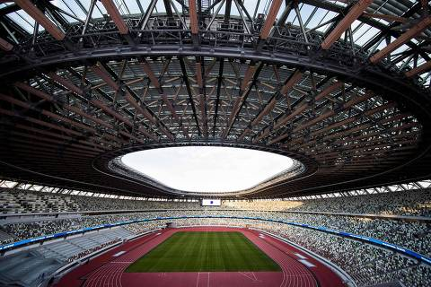 The National Stadium, venue for the upcoming Tokyo 2020 Olympic Games, is seen during a media tour following the the stadium's completion in Tokyo on December 15, 2019. - The Tokyo 2020 Olympics organisers on December 15 celebrated the completion of the main stadium that features use of lumber and other Japanese architectural tradition, seven months before the Opening Ceremony. (Photo by Behrouz MEHRI / AFP)