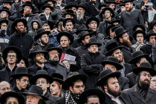 Orthodox Jews take part in the 13th Siyum HaShas, a celebration marking the completion of the Daf Yomi, a seven-and-a-half-year cycle of studying texts from the Talmud, the canon of Jewish religious law, at the MetLife Stadium in East Rutherford, New Jerse