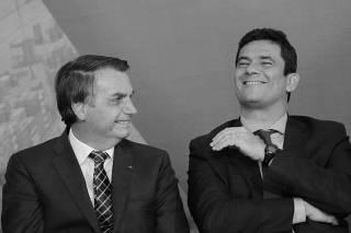 Brazil's President Jair Bolsonaro talks with Brazil's Justice Minister Sergio Moro during a ceremony at the Planalto Palace in Brasilia