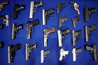 FILE PHOTO: Seized handguns are pictured at the police headquarters in New York City