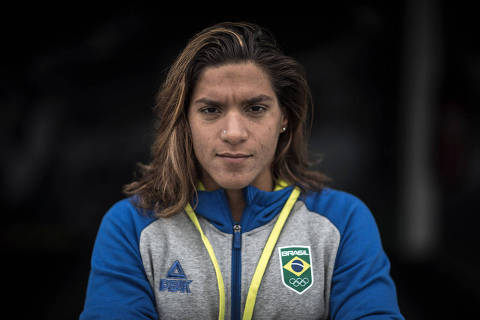 Ana Marcela Cunha, dona de 11 medalhas em campeonatos mundiais, com o uniforme da delegação brasileira no Pan de Lima