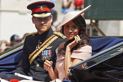 Britain's Prince Harry, Duke of Sussex and Britain's Meghan, Duchess of Sussex return in a horse-drawn carriage after attending the Queen's Birthday Parade, 'Trooping the Colour' on Horseguards parade in London on June 9, 2018.   The ceremony of Trooping the Colour is believed to have first been performed during the reign of King Charles II. In 1748, it was decided that the parade would be used to mark the official birthday of the Sovereign. More than 600 guardsmen and cavalry make up the parade, a celebration of the Sovereign's official birthday, although the Queen's actual birthday is on 21 April. / AFP PHOTO / Niklas HALLEN