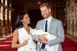FILE PHOTO: Britain's Prince Harry and Meghan, Duchess of Sussex with their baby son at Windsor Castle