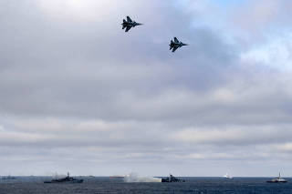 Russian Navy's ships and jet fighters are seen during the joint drills of the Northern and Black Sea fleets, in the Black Sea, off the coast of Crimea