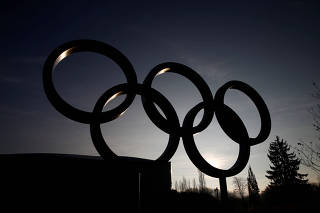 The rings are pictured in front of the IOC in Lausanne