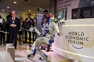 HUBO a multifunctional walking humanoid robot performs a demonstration of its capacities during the annual meeting of the WEF in Davos