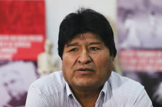 Former Bolivian President Evo Morales looks on during a visit to a group of Argentinian priests called