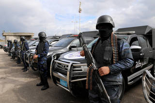 Central security support force carry weapons during the security deployment in the Tajura neighborhood, east of Tripoli