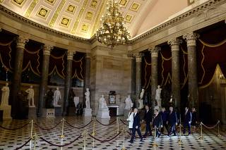 Secretary of the Senate Paul Irving, House clerk Cheryl Johnson and 7 managers walk through Statuary Hall with the articles of impeachment in two blue folders to deliver them to the Senate in the U.S. Capitol