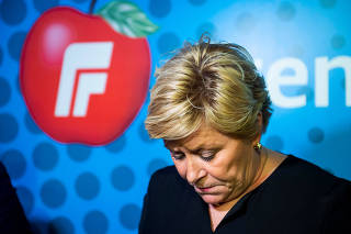 Norway's Progress party leader and Finance Minister Siv Jensen attends a news conference in Oslo
