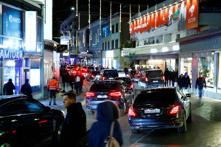 Cars jam on Promenade street in Davos