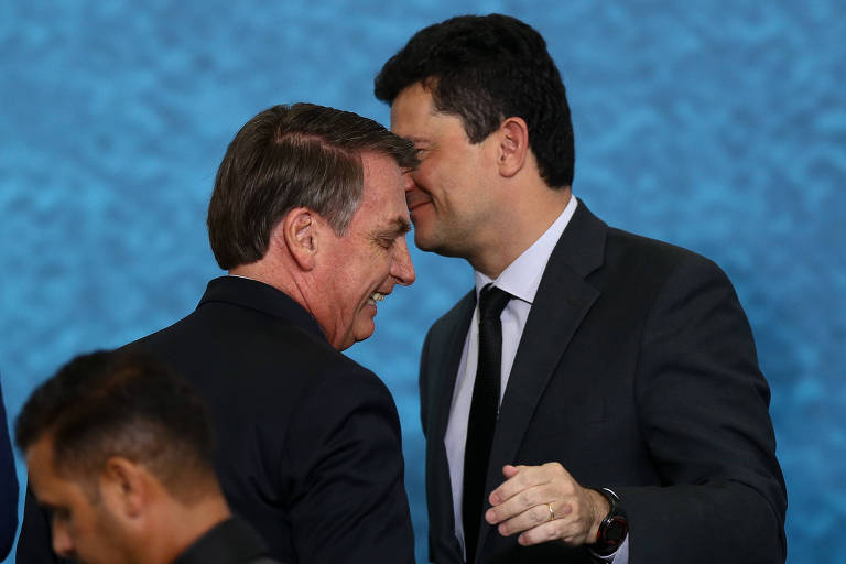 Jair Bolsonaro e Sergio Moro durante cerimônia no Palácio do Planalto, em outubro