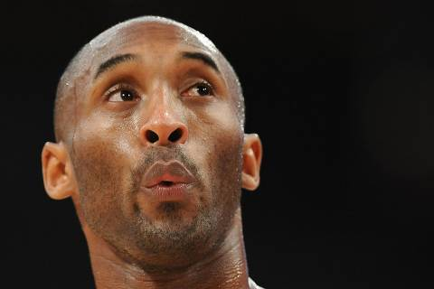 (FILES) In this file photo taken on February 12, 2013 Los Angeles Lakers Kobe Bryant looks up during the Lakers NBA match up against the Phoenix Sun at Staples Center in Los Angeles, California. - NBA legend Kobe Bryant died Sunday in a helicopter crash in suburban Los Angeles, celebrity website TMZ reported, saying five people are confirmed dead in the incident. (Photo by Robyn BECK / AFP) ORG XMIT: RLB733
