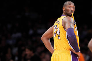 FILE PHOTO: Los Angeles Lakers' Bryant chews on his jersey during NBA game in Los Angeles