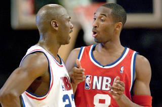 FILE PHOTO: Jordan and Bryant chat during NBA All-Star Game in Atlanta