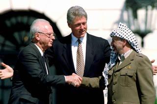 FILE PHOTO: File photo of U.S. President Clinton with Israeli Prime Minister Rabin and PLO President Yasser Arafat