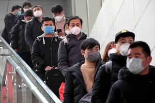 CHINA-HENAN-CORONAVIRUS-PREVENCION Y CONTROL-TEMPORADA ALTA DE VIAJES