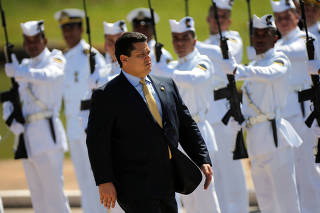 President of Brazil's Senate Davi Alcolumbre inspects the troops during an opening session of the Year of the Legislative in Brasilia