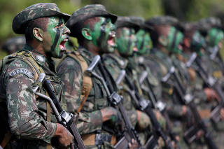 Brazilian Army soldiers react at the border with Colombia during a training to show efforts to step up security along borders, in Vila Bittencourt