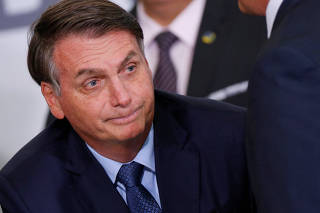 Brazil's President Jair Bolsonaro looks on during a ceremony marking his 400 days in office at the Planalto Palace in Brasilia