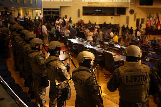 Soldiers stand inside the national congress as the president of El Salvador Nayib Bukele assist to a special session in San Salvador