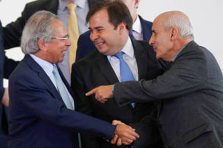 Brazil's Economy Minister Paulo Guedes talks with  President of Brazil's Lower House Rodrigo Maia and  Brazil's Minister of the Secretariat of Government Luiz Eduardo Ramos before  an inauguration ceremony of the new Regional Development minister Rogerio M