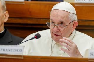FILE PHOTO: Pope Francis speaks at a conference hosted by the Vatican on economic solidarity, at the Vatican