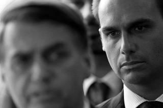 Eduardo Bolsonaro, son of Brazil's President-elect Jair Bolsonaro is seen behind him at the transition government building in Brasilia