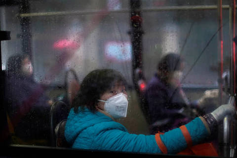 Woman wearing masks are seen on a bus, in downtown Shanghai, China, as the country is hit by an outbreak of a new coronavirus, February 13, 2020. REUTERS/Aly Song ORG XMIT: GGGSHA17