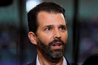 Donald Trump Jr. talks to a reporter before U.S. President Trump holds a campaign rally in Manchester