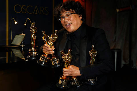 FILE PHOTO: Bong Joon Ho poses with the Oscars for