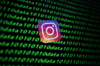 FILE PHOTO: The Instagram logo and binary cyber codes are seen in this illustration