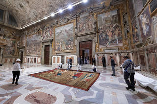 A tapestry designed by Renaissance artist Raphael is installed on a lower wall of the Sistine Chapel at the Vatican as part of celebrations marking the 500th anniversary of his death