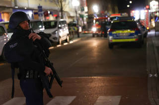 Police officers secure the area after a shooting in Hanau near Frankfurt