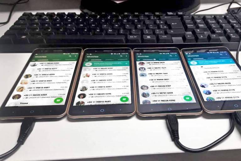 Imagem de telefones apresentada em CPMI que sugere envio de mensagens contra campanha de Fernando Haddad (PT) em 2018