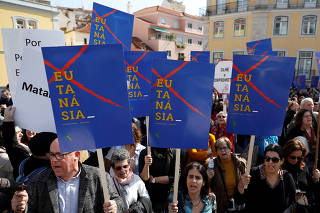 Demonstrators protest against euthanasia before a vote at the Portuguese parliament in Lisbon